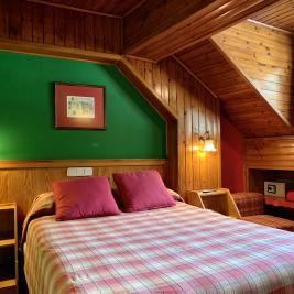 Chambre double lit king size Hotel Aran la Abuela Vielha